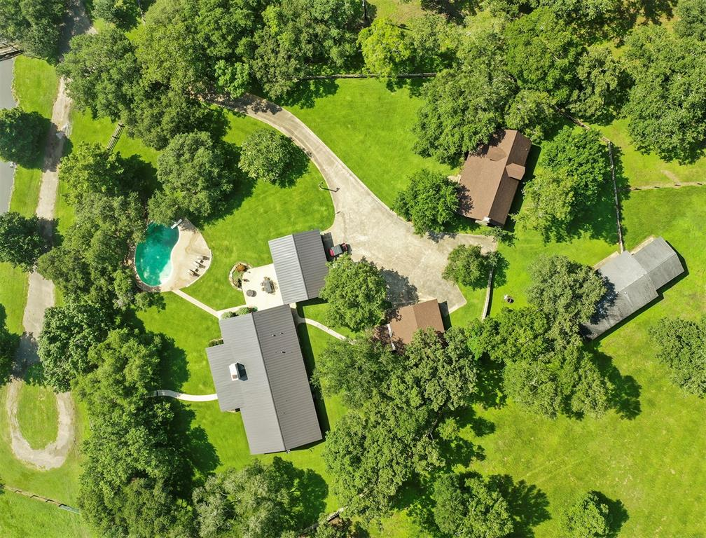 This IMPRESSIVE Ranch is located in Gonzales County in the highly sought after triangle between Austin, San Antonio, and Houston on Sandy Fork Creek. The ranch is located 3.8 miles from I-10 and is a 75 minute drive from both Austin and San Antonio, 1 hour 45 to the outskirts of Houston.  This ranch comes complete with a 1 story ranch house (2880 sq feet) with 2 BR, 2 1/2 baths with front porch views of the rolling terrain and the 8 acre pond fed by an Artisan Well.  A gorgeous Log Cabin (1900 sq ft) with 3BR, 1 bath, kitchen, laundry and living areas. There are 3 auxiliary buildings to include garages, carports and storage and coverage for your tractor or ranch equipment. There is a second pond also fed by well as well as a gorgeous swimming pool overlooking the property.  Recent renovations:  New AC's, New Roofs (Tin and Composition), New Paint, Fence and all New Double Pane Windows.  60+ Native Pecan Trees, Oaks, Deer, Turkey, Fish and Hogs complete this country living experience!