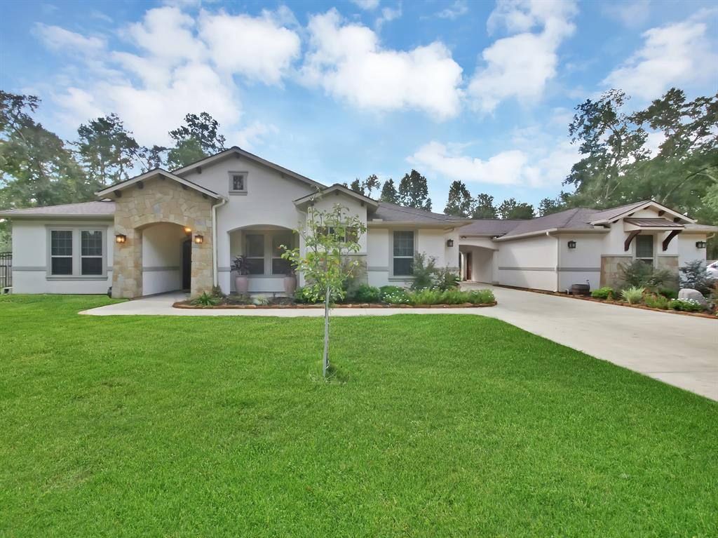 Beautiful 2015 Custom-built Home on large lot with easy access to 249 & 99. Spacious and open floorplan with high ceilings. Large master bedroom with sitting area and LUXURIOUS Master bath with large shower and 2 showerheads. Granite countertops throughout the home and stained concrete flooring. LARGE MEDIA ROOM UPSTAIRS with balcony overlooking pool and cabana, BREATHTAKING KITCHEN, LARGE MUDROOM, OVERSIZED 3 CAR  Garage, BEAUTIFUL HEATED POOL with spa and cabana, 3 panel sliding glass doors that open up to the AMAZING Outdoor living area COMPLETE with fireplace AND grill, !!! Home has never been flooded. REAL BEAUTY!! Room dimensions are approximate.