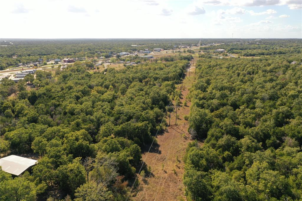 25 acres of property in close proximity to TX 71. Only 5 acres of this land is restricted and the remaining is unrestricted. Property backs to Bastrop's prestigious neighborhood The Colony and also borders The Woodlands. Come build your dream home and have plenty of land to play on all while being close to Bastrop and Austin.