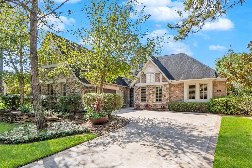 Rare Opportunity to own a Darling-Built Single Story home- 3252 sqft/Montgomery Co. Appraisal District! Located in the upscale, upfront  Panther Creek Neighborhood of The Enclave on the Cove, a small community of 41 Patio Homes adjoining Lake Woodlands, it is 5-10 minutes from Hughes Landing, Market Street, Town Center and ALL The Woodlands has to Offer! Highly Upgraded with Plantation Shutters, Wood and Tile floors (new carpet-installed 10-19 ONLY in 2 secondary bedrooms+hallway leading to them).Gorgeous Kitchen designed for Multiple Chefs:granite topped 12' island, abundant drawers + cabinets, decorative stacked stone surround over gas range, under counter lighting. Natural lighting from windows out to atrium and back yard + recessed lighting added by seller throughout the living areas. Upgraded Showers and Countertops in Master and Secondary Full Bathrooms. Master has HUGE walk-in closet. Built-in cabinet near Dining and Living areas set up as Wine Cabinet. HOA maintains front yard.