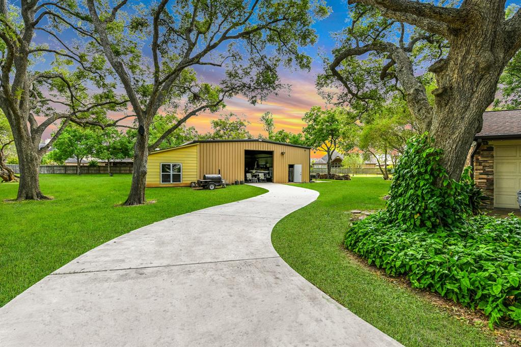 Amazing OPPORTUNITY to own a little piece of PARADISE minutes from I-10 and the Grand Parkway with NO HOA, and NO RESTRICTIONS! This 3200 square foot home has been totally remodeled and sits on 3 acres best described as a parklike setting. On the property are an abundance of pecan trees, crepe myrtles, pear trees, oak trees, and many others. The large outbuilding in the back is the perfect storage space for your boat, RV, ATV's, and there's plenty of room to make it an office or guest quarters. Located inside the home is the absolute best kitchen EVER - all Viking Professional appliances which include: double ovens, refrigerator, freezer, (drawer style) microwave, dishwasher, food warmer, cooktop, ice machine, and downdraft ventilation, plus an enormous island for preparing and serving meals which features a cook sink, spice rack, built-in receptacles, and more. Other recent improvements include a roof, 2 gas furnaces, 2 a/c units, 2 tankless water heaters, and a natural gas generator.