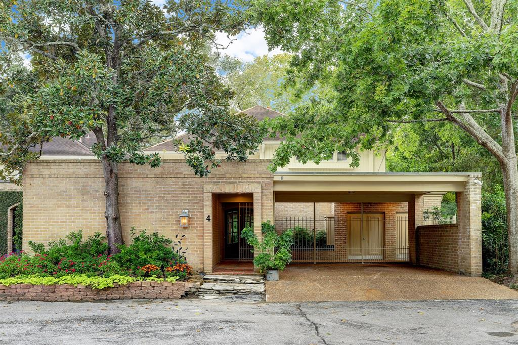Nature lovers will love this end unit situated on Buffalo Bayou offering a SERENE and PRIVATE setting.  This home is perfect for entertaining inside and out.  Walls of windows provide beautiful views and bring the outdoors in.  The home has been fully renovated and remediated post-Harvey *per seller and is ready for immediate occupancy.  The home offers two master suites - one upstairs and down!  The new kitchen adjoins the casual den and has the perfect breakfast spot to start your day or enjoy weekend brunches.  The living areas are open concept with an excellent flow and fabulous views.  The new wet bar/wine room area just enhances the entertaining possibilities.  The back deck features a screened in sun room to enjoy the outdoors no matter what mother nature has in store.  Upstairs has three bedrooms and two areas of flex space.  One perfect for study with built-ins and one with mirror and bar for home yoga studio/gym.  Woodstone enjoys award winning SBISD schools.