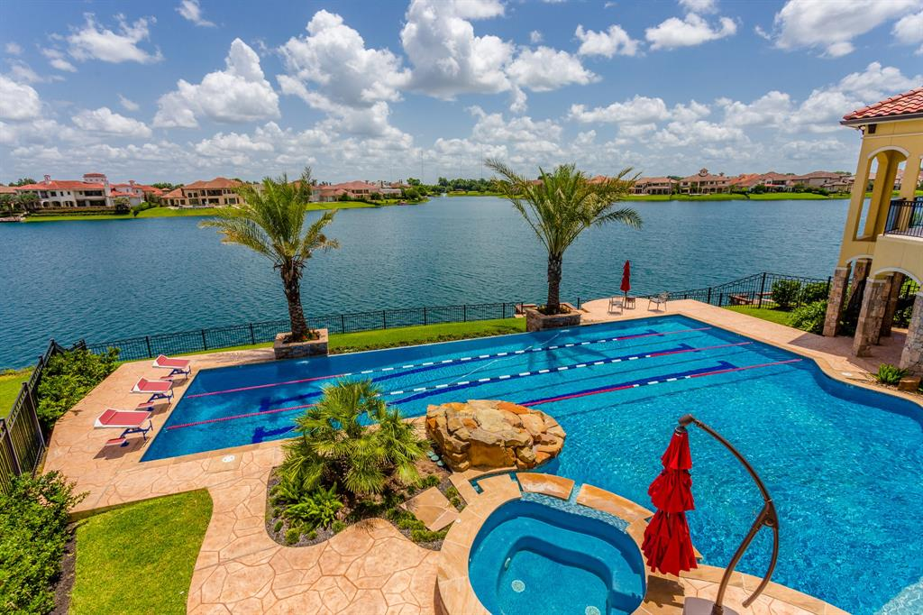 THIS LUXURIOUS CUSTOM WATERFRONT ESTATE IS AN ENTERTAINERS PARADISE! LOCATED IN RIVERSTONE'S EXCLUSIVE GATED COMMUNITY OF MAJESTIC POINTE AND SITUATED ON ONE OF THE BEST WATERFRONT LOTS RIVERSTONE HAS TO OFFER. LUXURIES & AMENITIES THAT RIVAL TOP WORLD CLASS RESORTS, THIS HOME HAS IT ALL! INDOOR SPORTS COURT, MEDIA ROOM DOWNSTAIRS, GAMEROOM DOWNSTAIRS THAT HAS AN  ALL-GLASS GARAGE SHOWCASE TO SHOW OFF YOUR FAVORITE CAR, ENORMOUS RESORT STYLE POOL WITH OLYMPIC STYLE SWIMLANES, GOLF PUTTING GREEN, HUGE BALCONIES AND PATIOS, OUTDOOR FIREPLACE, OUTDOOR KITCHEN, ELEVATOR, WINE AREA ALL OVERLOOKING BREATHTAKING WATER VIEWS! WHILE PERFECT FOR ENTERTAINING THIS HOME IS GRACIOUSLY ELEGANT. CUSTOM CEILING TREATMENTS, CRYSTAL CHANDELIERS, FIT AND FINISH IS WORLD CLASS, APPLIANCES ARE TOP NOTCH.  WITH ALL THESE INCREDIBLE FEATURES THIS PLACE STILL FEELS LIKE HOME AND A WONDERFUL PLACE TO RAISE A FAMILY. FORT BEND ISD SCHOOLS AND CLOSE TO SHOPPING, DINING, 59, 6 & FT BEND TOLLWAY! THIS IS IT!