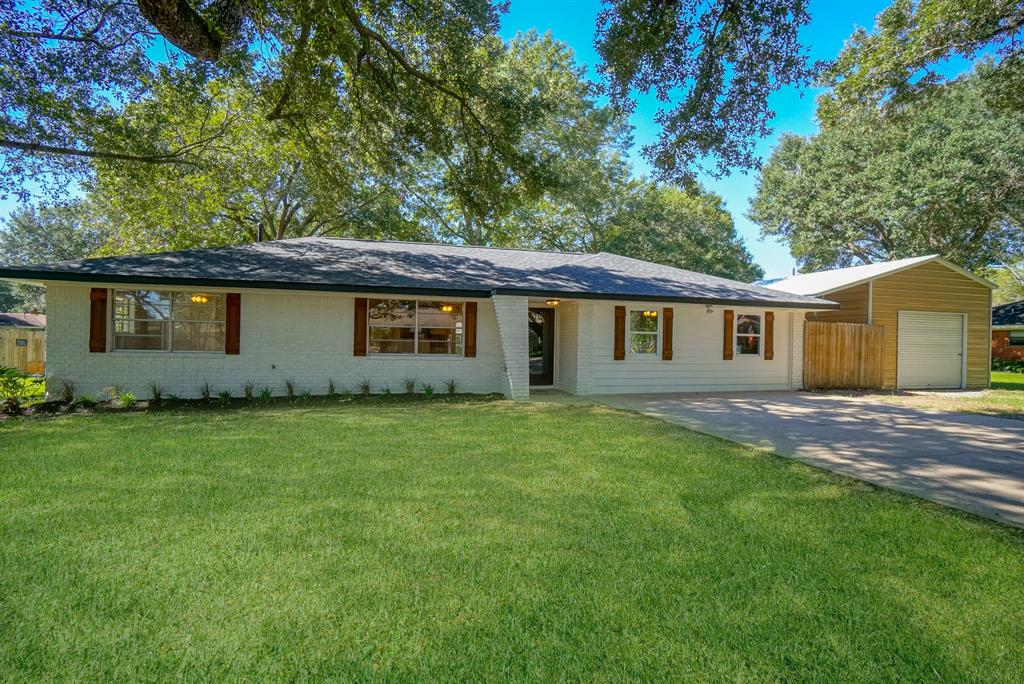 How cute is this house?!?!  Fabulously remodeled and ready for you to call it home. BIG living room and open kitchen make it perfect for entertaining.  Tons of natural light!  Granite countertops, custom, soft-close cabinets and glass tile backsplash.  Some updates include new roof (2019), new water heater (2019), new paint inside and out, and custom cedar shutters.  Huge master suite with new laminate flooring and walk-in closet.  Both bathrooms have been completely remodeled including subway tile shower, vanities, light fixtures, and ceramic tile flooring.  And talk about an awesome master shower!!  Big back yard with patio underneath the trees for a morning cup of coffee or an afternoon bbq.  Large detached workshop with additional covered storage for all your toys.  Zoned to popular Needville ISD.  Close to dining, shopping, and entertainment at Brazos Town Center.  Come take a look!