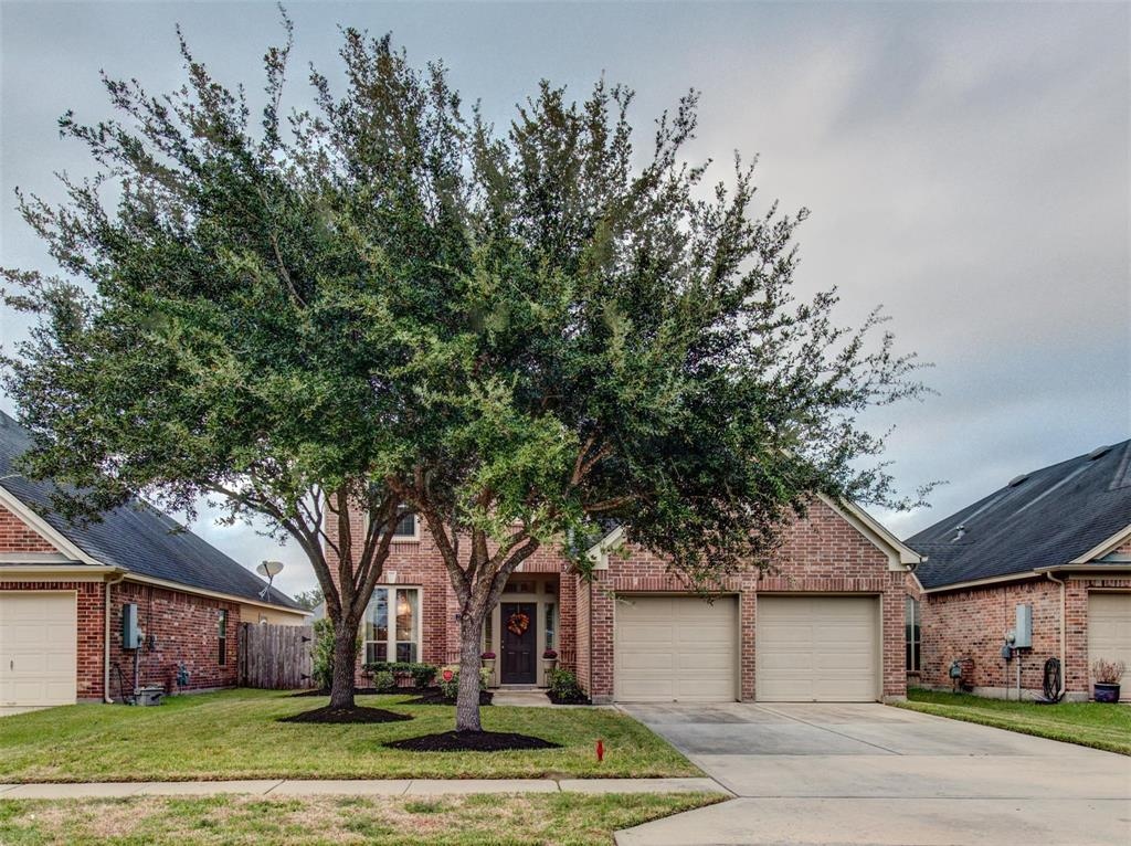 """This Beautiful 2 story 4/2/1 Perry Home has great curb appeal. It is located in the front of the subdivision and only minutes from fort bend toll and 288. Home has wood floors throughout,Custom drapes in formal dining room. Open Bright floor plan with lots of natural light, plantation shutters in breakfast area, Large Family room with 18' high ceilings with natural light and custom drapes, built in TV/book case with Mock Fireplace, kitchen has granite countertops, 42"""" cabinets/ gas stove, stainless steel appliances.  Master Suite is spacious with large windows, master bath double sink, separate shower/tub, walk-in closet. Upstairs offers game room, 3 spacious bedrooms walk-in closets. Nice size back yard for the kids to play, sprinkler system.   This home is a must see!"""