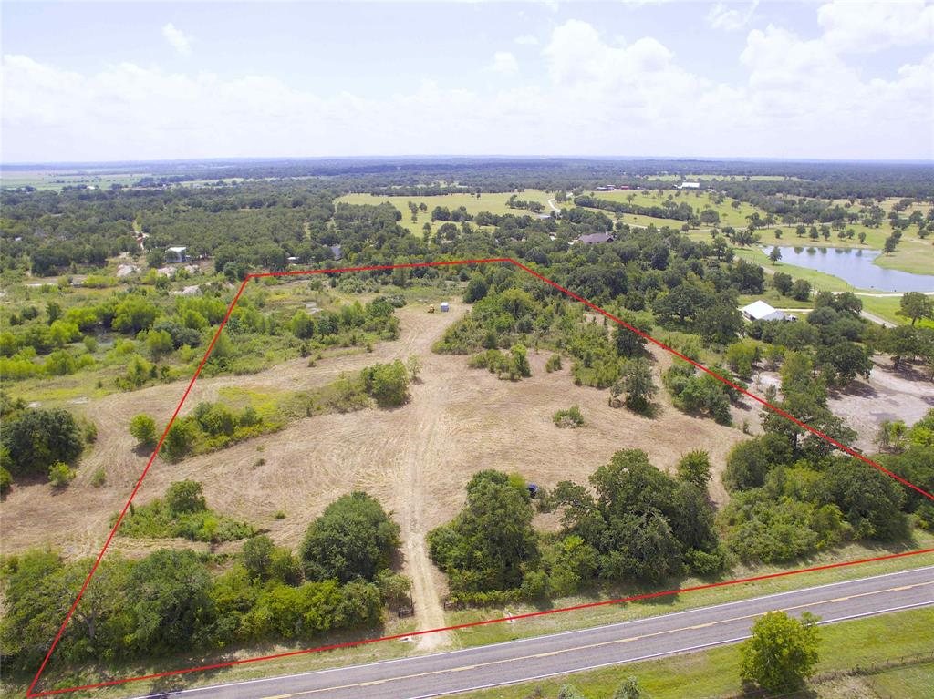 Within 20 minutes of Texas A&M this elevated tract of land sits high overlooking the surrounding area. The land offers multiple hilltop building sites, nice sized trees, lots of paved road frontage, and gentle rolling topography. Entrance has 16' gate and a 330' long, 12' wide driveway. With it's great location and the large oaks offering seclusion and privacy from the road this property would make a great place to build a home or a nice place for a weekend getaway. Come and see all it has to offer.