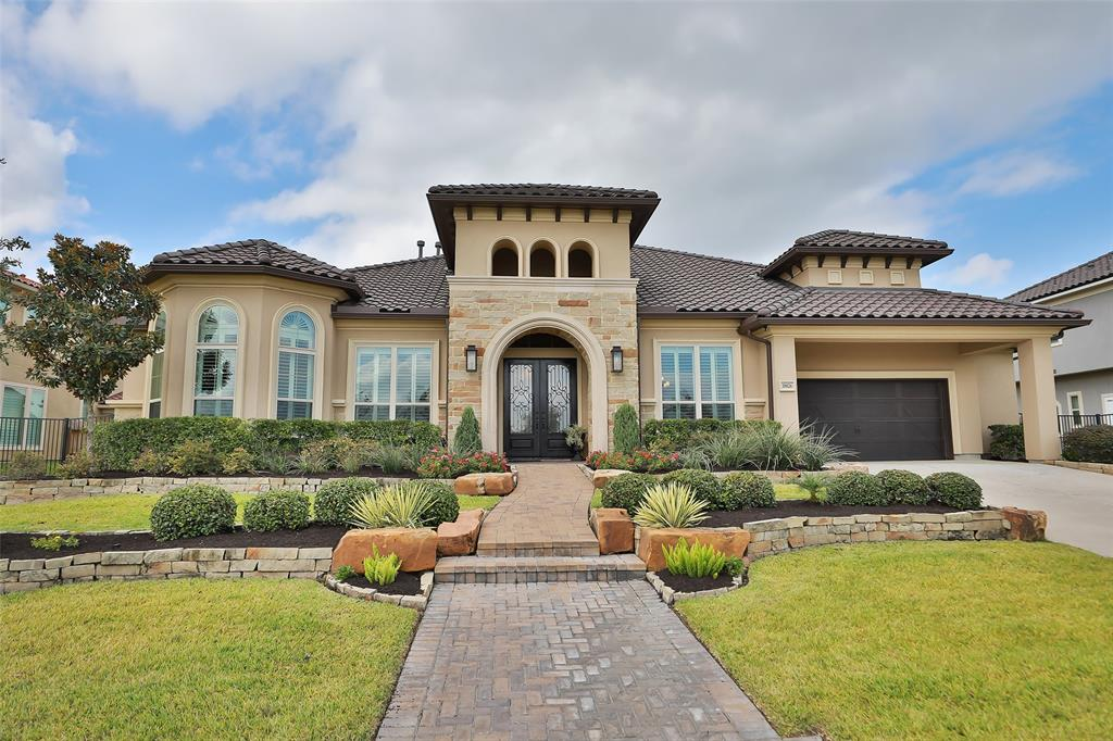 Stunning and immaculate in design, this custom Perry home is located in the gated neighborhood of  Hidden Creek Estates within the award winning master planned community of Bridgeland. Breathtaking water views and miles of nature trails greet you upon entering.  Dramatic double doors open to spectacular foyer with 14 foot ceilings, gleaming hardwood floors and designer finishes.  Continuing through the rotunda you will enter the great room which overlooks the sparkling pool and spa! A true gourmet kitchen that features a massive island, double ovens and gas cooktop and griddle. The master suite has a private sitting area and spa like bathroom with his/her everything. Wait!  There is also a 4 car garage with porte cache!  Four bedrooms and 3 1/2 baths. Just minutes to 99.  When you are not relaxing on your covered patio you can enjoy all of the many amenities available to you in Bridgeland. Zoned to Cy-Fair's newest schools. The property has been meticulously maintained. Love it!