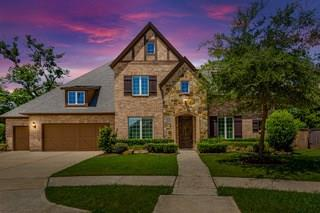 NEW ROOF! Spectacular 5 bedrooms 5.5 bath custom home built by trusted builder Darling Homes. Located in award winning gated community of Avalon at Riverstone. Upon entry greeted with private courtyard, En Suite perfect for guests to the right, & formal Study to left. Dedicated Dining Room offers crown molding, high baseboard, & exquisite custom chandelier. Winding staircase, custom chandeliers, & fixtures add to the elegance of this home. Gourmet Kitchen boasts with beauty from the granite counter tops, tile backslash, custom cabinetry, island, & high end appliances. Spacious Living Room with soaring ceilings, wall of windows, fireplace & wood beam ceiling. Master Suite offers additional private sitting area as well as a bonus room! Media Room! Spacious Game room! Secondary bedroom offers private custom built in desk as well as raised ceiling and arched entry. Large backyard with covered patio and outdoor fireplace! Zoned to exemplary Sugar Land schools!