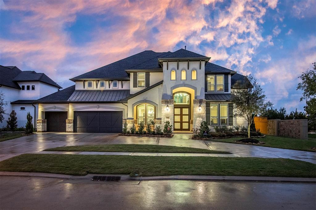 Welcome home to this 2018 modern SHOWPLACE built by Avanti Custom Homes by Trendmaker is 5,368 sf and situated on a premium 14,000+ sf lot in the exclusive Creek Cove at Cross Creek Ranch! Great floorplan including 5 bedrooms, 2 DOWN, 5 FULL baths & 1 half bath plus beautiful hardwood flooring, plantation shutters, amazing light fixtures & dry bar under staircase! Huge CUSTOM DETAILED family room w/ impressive coffered ceiling, 2 story stone fireplace & wall of windows making this home light, bright & inviting! Gourmet kitchen w/ huge island, granite counters & double ovens! 20 ft long master suite w/ bay windows & bath spa. Upstairs is a game room, custom media room you won't believe, study space with built-ins plus secondary bedrooms. You'll enjoy outdoor entertaining on the covered back porch and enormous pool size back yard with a great view - NO back neighbors! Circle driveway leads to 3 car split garage w/ workshop! You won't find another home like this one! No flooding!