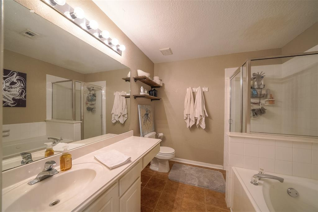 Master Bathroom features a whirlpool tub and separate shower.