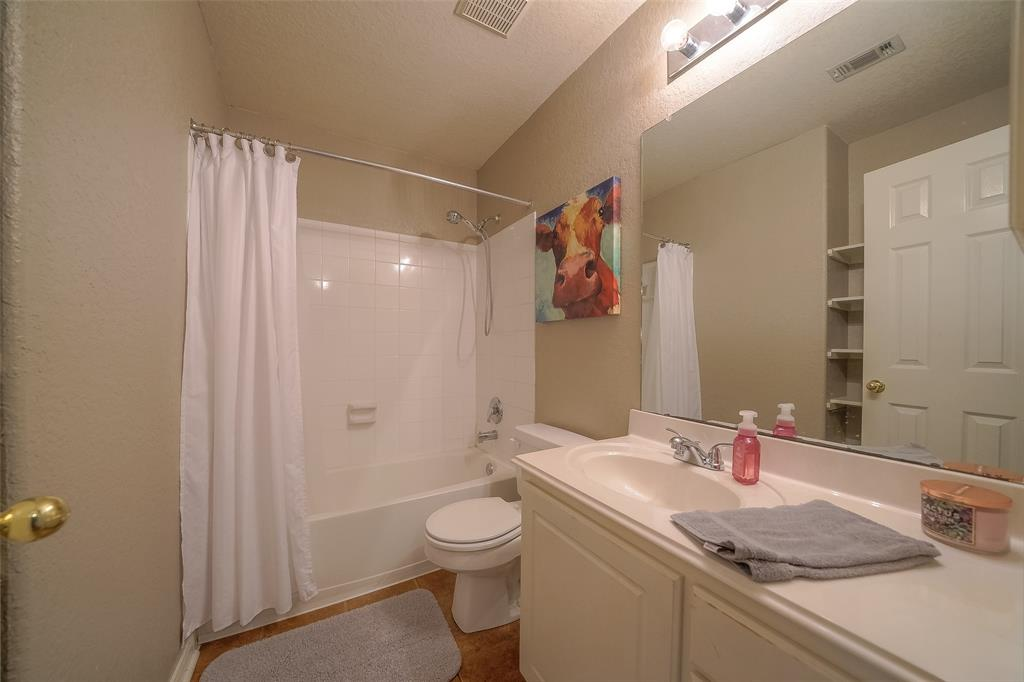Full Bath outside of second and third Bedrooms.
