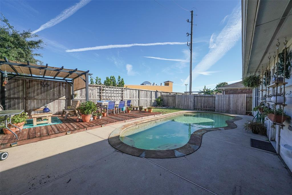 Gorgeous back yard is designed to entertain! Enjoy the sparkling pool and the Gazebo STAYS!
