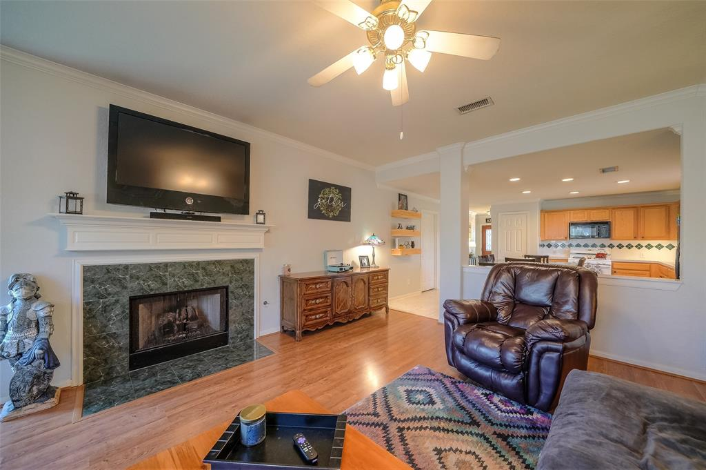 Gorgeous Gas Log Fireplace with mantel and marble detail make this Living Room very inviting with great character.