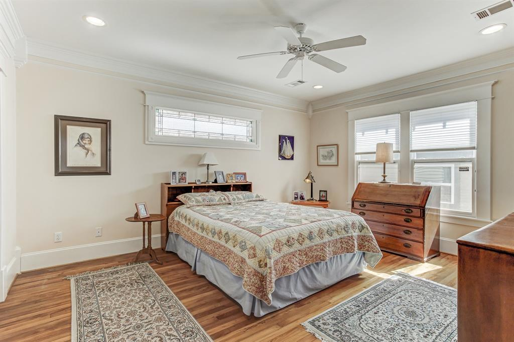 This is the master bedroom, which could readily accommodate a king sized bed and bigger side tables.  There is a walk-in closet in this room, fairly unusual for a home of this age and style.