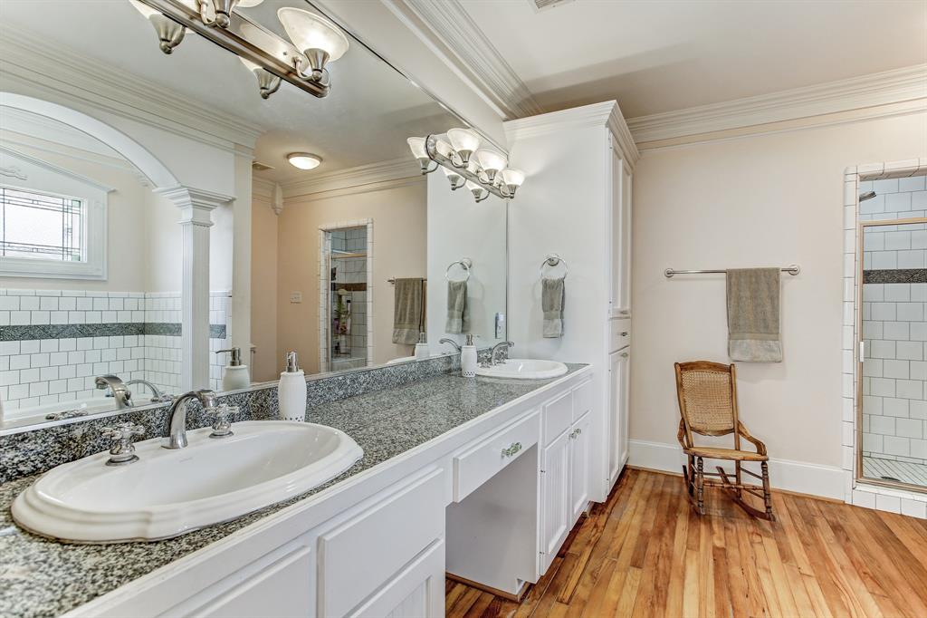 The master bath is quite big, with a double sink vanity, large separate shower stall, jetted tub and wonderful cabinet/storage space.