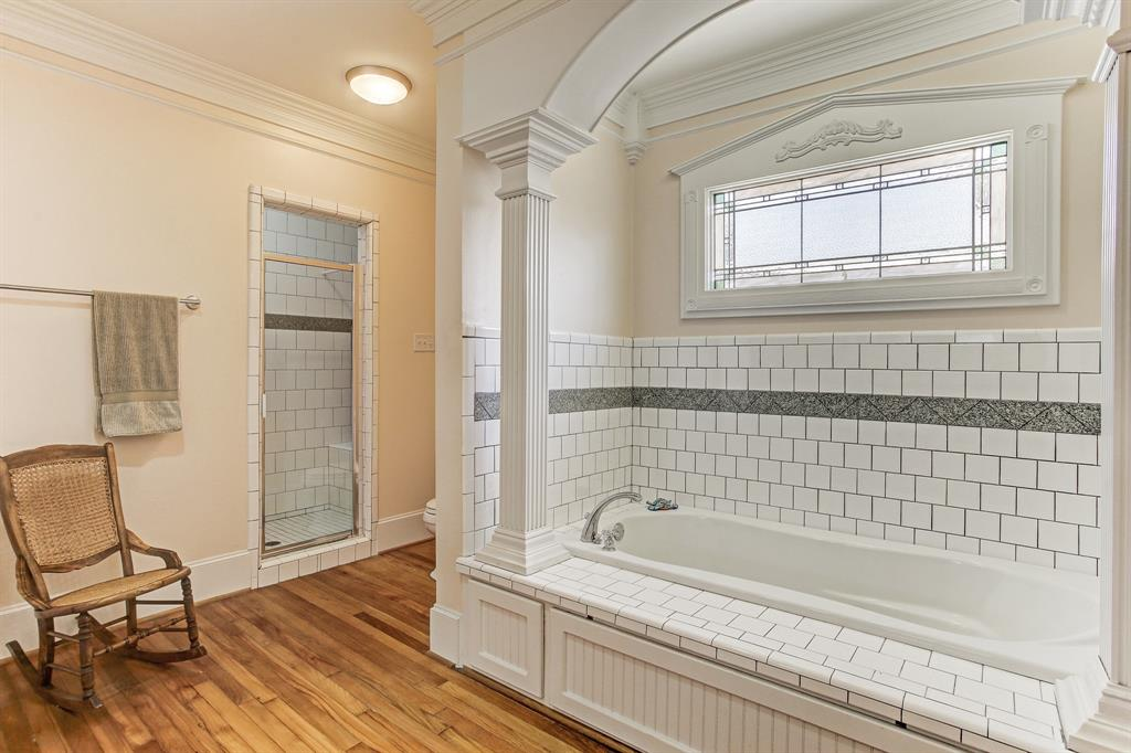 The shower stall includes a bench and you get wonderful light from the stained glass window.