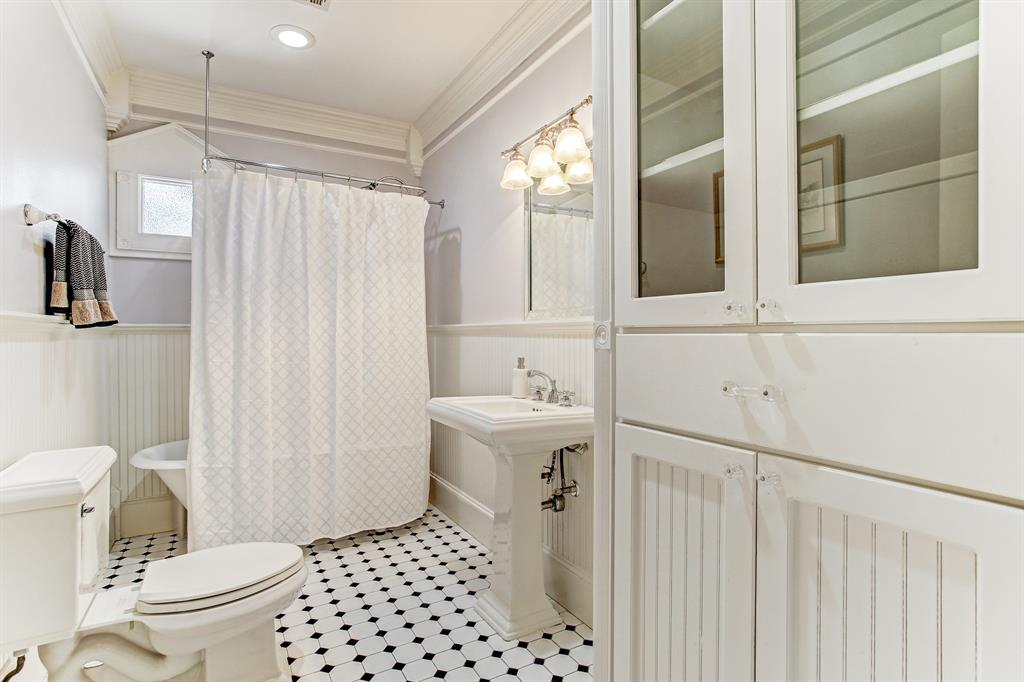 The guest bath is also very roomy, with wonderful storage space in the cabinet to the right.