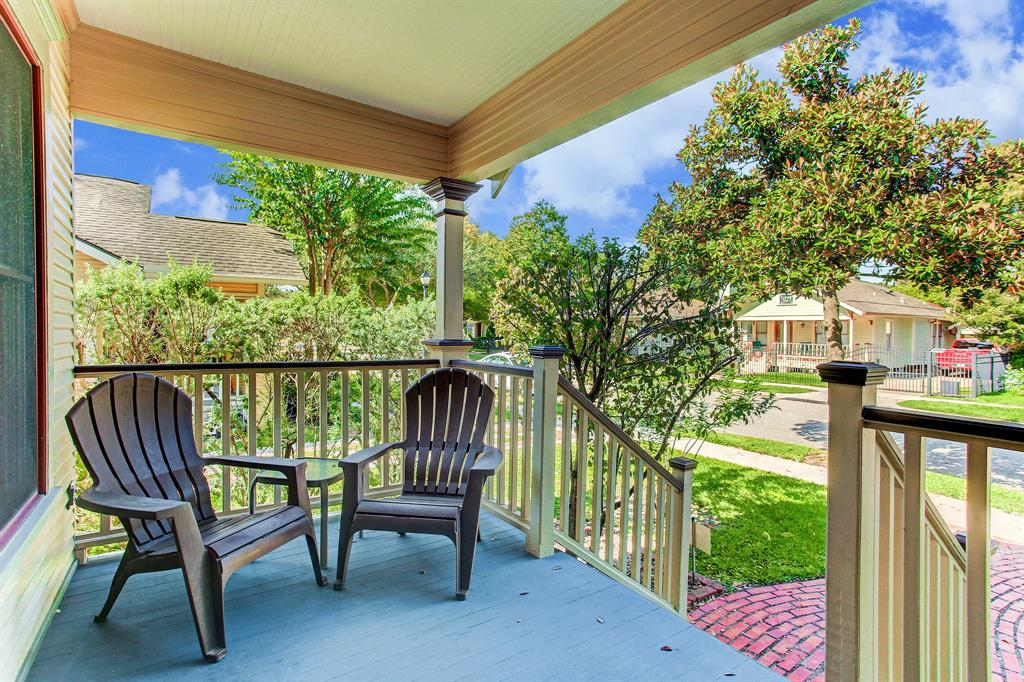 The front porch is just the right size for a couple of comfortable chairs and side table.