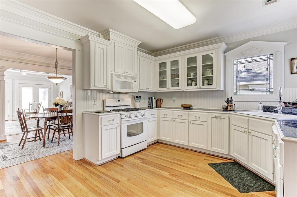 The kitchen is spacious and could accommodate an island.