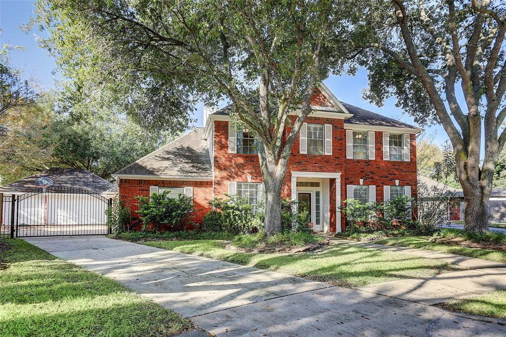 RARE FIND!  HUGE (11,9991 sq. ft.) cul-de-sac lot in a quiet section of New Territory offers a SWIMMING POOL, THREE CAR GARAGE, and private DRIVEWAY SECURITY GATE. Facing east, this beautiful home offers 4 bedrooms, plus a game room and 2.5 baths. UPDATED KITCHEN with BRAND NEW DOUBLE OVENS, updated stainless steel microwave, and dishwasher,  plus amazing pull-down spray faucet and EXOTIC GRANITE COUNTERS. The massive kitchen and breakfast room also offers a seating area with a double-sided fireplace. You'll find tons of upscale finishes throughout like: Granite counters in the master bathroom, frameless glass shower enclosure, crown molding, rich flooring, updated lighting, sliding barn door entrance into the master bath, and neutral paint.  Surrounded by mature trees, the expansive COVERED PATIO is ideal for entertaining.  Dive into the EXTRA LARGE SWIMMING POOL with beautiful fountains. Zoned to excellent FBISD schools. Call today to schedule your private tour!