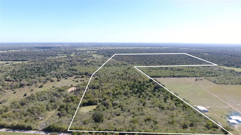 107.46 ACRES in southern Bastrop county with 25 % of minerals to convey with accepted offer. Approximate 755 ft. of road frontage on CR 297/Jeddo Rd. Aqua rural water and electricity are nearby. Wildlife is abundant in the area, deer, turkey, hogs and dove. A vein off Peach Creek runs through the back part of property providing a perfect haven for wildlife. The property shape offers a division for a weekend or permanent residence and hunting/outdoor activities in the back area of the property. A pond sits in the front which would make the perfect setting for a home. There is a mixture hardwoods and underbrush for good hunting. Presently used for cattle with agriculture in place. A new fence will be needed on the northern boundary. The 100 year flood zone lies in some areas of the back property. Only 50 minutes from Austin-Bergstrom Airport, 25 minutes from IH 10/Flatonia and 10 minutes just north of Cistern. . A new tax ID number will be issued in January 2020.
