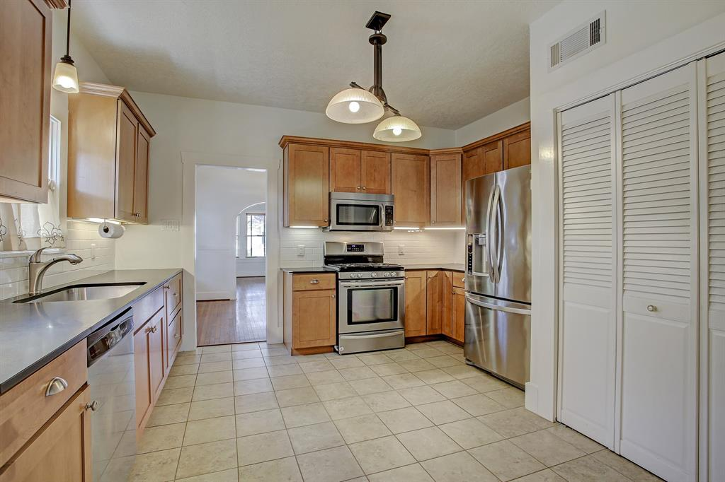 This kitchen is big, and an island could readily be added for additional counter space.  Side-by-side laundry is in the closet to the right.  All appliances transfer with the sale.
