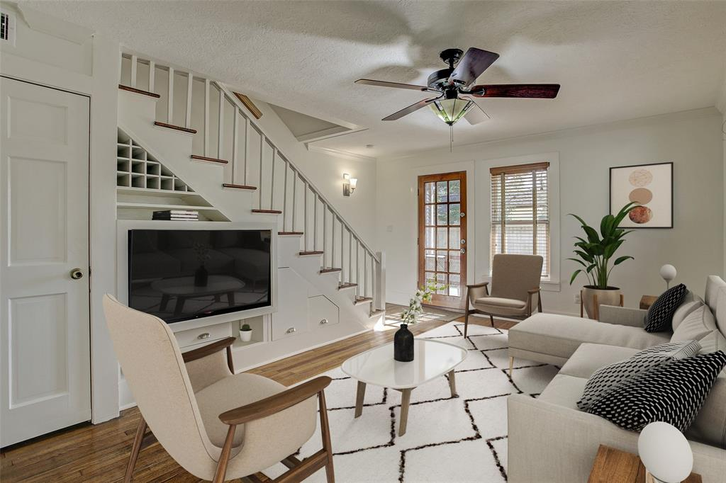 The family room has a fabulous walk-in closet under the stairs, as well as the space around the TV mount fully utilized.  The door leads to the back yard.  (This room has been virtually staged.)