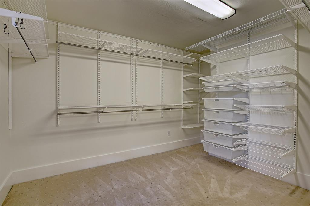 This master closet is the size of a small bedroom, and adequately sized to be turned into a bath, if a closet is added at the opposite end of the bedroom.