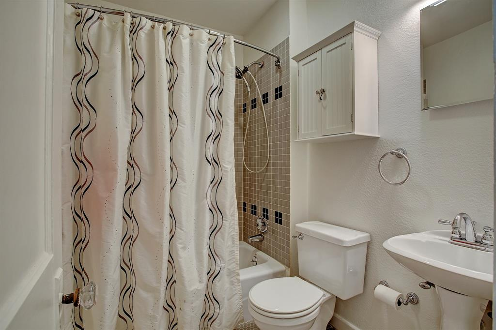 The full bathroom on the second floor sits between the third bedroom and play room/study/guest room.