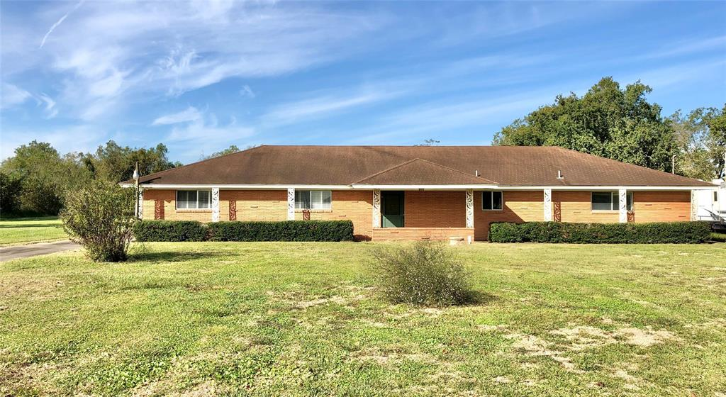 Country feel- close by! All brick home on 2.0 ACRES just outside the city limits! Interior features an open concept kitchen/dining/living space. Fridge is included. Master has his & hers closets and attached bathroom with an oversized vanity and stand-up shower. Plantation shutters on all the bedroom windows. Original garage was converted into a huge bonus room & laundry room. Room for big things- 3 car garage, storage building, and 1,280 sqft metal barn with concrete floors & electrical. Stretch out & relax! Room dimensions are approximate.