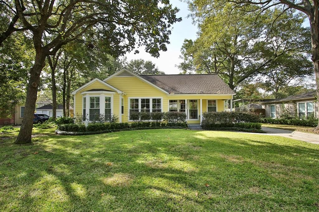 Absolutely charming Garden Oaks bungalow.  Beautiful hardwood floors throughout.  Cozy living room with mock fireplace and wall of windows looking out to front.  Sitting/family room just off living can be closed off with nice double French doors.  Dining room shares the same floor to ceiling windows and lets in plenty of natural light.  Kitchen was remodeled in 2017 (per seller) and includes quartz counters, large apron sink, beautiful marble backsplash behind stove and cute breakfast area.  Upstairs has a bedroom with adorable reading nook and huge bonus room/playroom with closets.  Behind the 2 car garage is another bonus area that can be an office or yoga/gym.  This home sits on an over 12,000 square lot (per HCAD).  Walking distance to shopping, retail and restaurants!