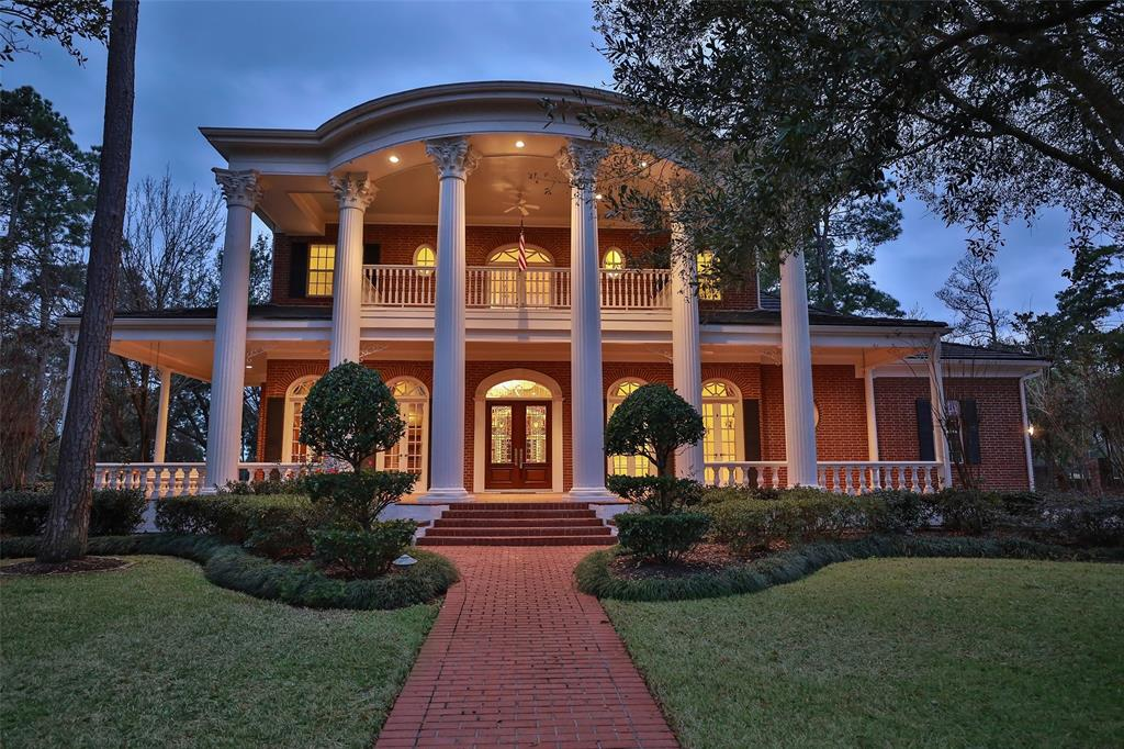 An impressive home in every respect. From the Neo Classical Southern Plantation style curb appeal to the calming golf course views from the front and back balconies, this stunning home is a projection of your lifestyle. Located in Estates of Northgate Forest on the Golf Course in an exclusive gated Country Club and Golf Course community. Brick paver walkway leads to a huge covered front veranda with a balcony above! Impressive foyer & dining room have imported crystal chandeliers and wall scones. The living room, den, dining room, study, kitchen, game room & master all have incredible views of golf course & lakes. A sparking pool and spa is to the right of the back veranda. Two fireplaces compliment the living room & game room. Game room has huge balcony overlooking 2 fairways. High ceilings, open concept and 2 staircases make this home perfect for entertaining.