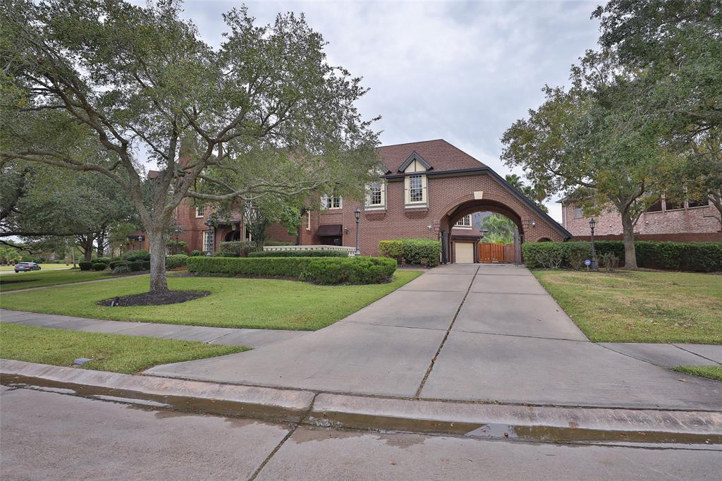 Live the life you've dreamed of in this stately six-bedroom home situated in Pearland's Southwyck community. Rich wood trim and hardwoods are found throughout this uniquely designed home with amazing Family Room that boasts a floor to ceiling brick wall with wood burning fireplace. Stained wooden beams and the soft glow of Craftsman style chandeliers give this home a comfortable luxurious feel. The Chef's Kitchen is equipped with professional grade stainless steel appliances, granite topped counters and Kitchen Island. The Mast Suite is grand with its sitting room and master Bath fit for royalty. Bask in the comfort of the backyard oasis with swimming pool, spa, and covered gazebo. The three car attached garage has a garage apartment above with living area, kitchenette, and bedroom that's ideal for company, a live-in nanny, or adult child. Don't waste a minute to see all the beautiful details too many to list here!