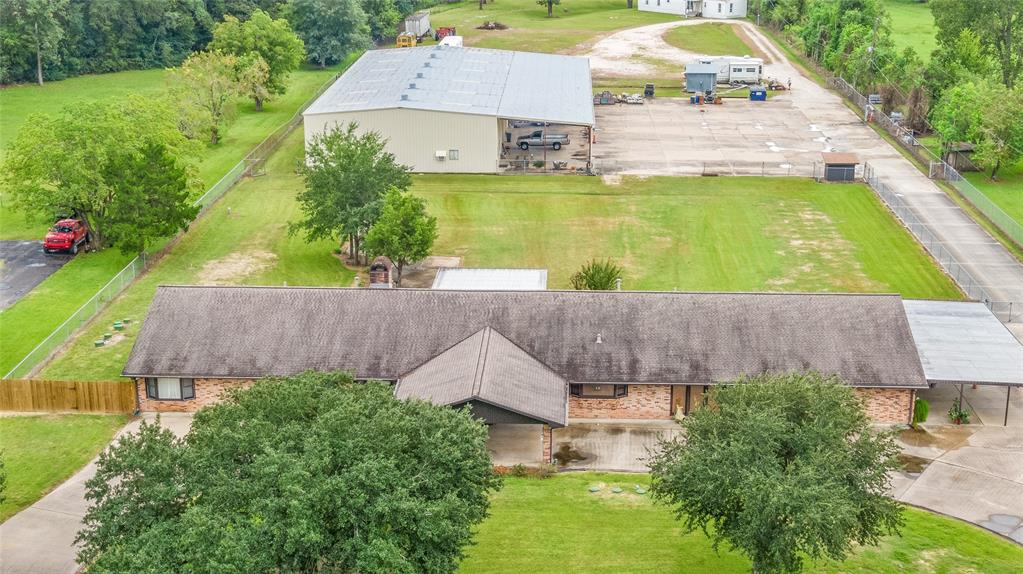 Almost 5 acres of Commercial/Residential Property with a 4000 sq. ft. single story home, 9000 sq. ft. shop with offices, Bay doors, plenty of storage, overhang and a completely remodeled 20x80 Mobile Home. Aerobic Septic System was installed in 2018. Water Well, Extra Parking. Inside this Beautiful Custom Built home you will find large rooms with plenty of living and entertaining space for everyone. In house vacuum system, double sided fireplace, 6x36 enclosed breezeway between the home and garage, 2 master bedrooms and much more. If you are looking for a place that has it all, your look is over!!! More Photos coming soon.
