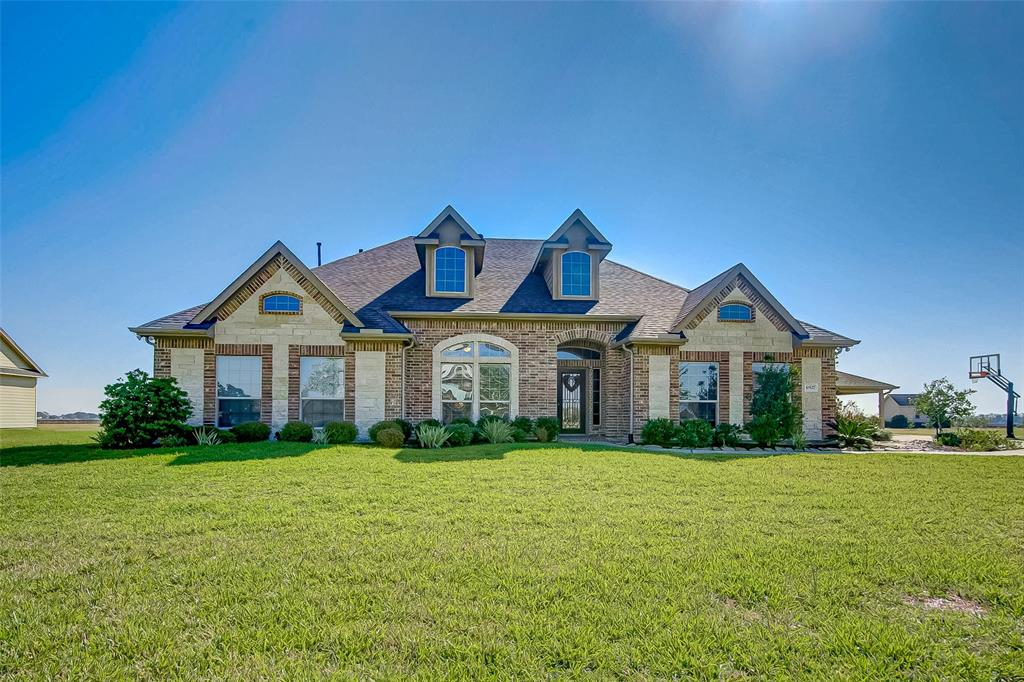 Highly sought after ONE story custom home in the gated acreage community of Tejas Lakes. The exterior consists of 3 car garage, extensive concrete walk areas, professionally landscaped w/drainage, extended back patio, and 1.2216 Acres with no back neighbors. Interior is stunning! Consisting of hand scraped luxurious wood floors as well as large neutral tile floors and crown moulding throughout most rooms.  There is a Formal living room/Office/Study to use as your preference, Formal dining room, and a distinguished built-in bar with stone details and spotlights to showcase your liquor and/or wine collection.  The kitchen has all the amenities you would expect in addition to under cabinet lighting, island with storage, breakfast bar and breakfast room.  The living room is spacious with fireplace and picturesque windows that provide endless views of the acreage in back. All rooms are generous in size with master bed split from additional rooms for added privacy. Zoned to Needville ISD.