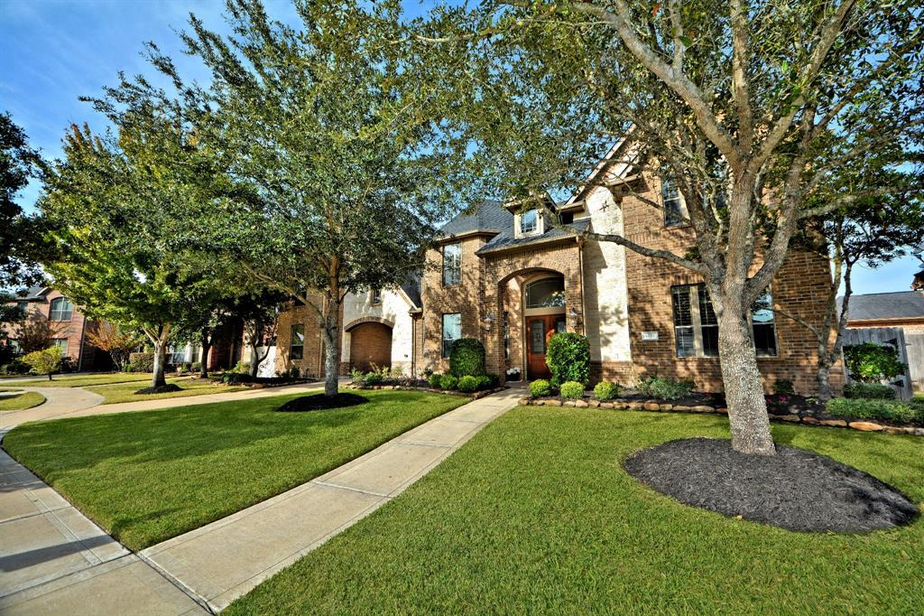 Stone & Brick Elevation, Port-Cochere W/3/Attached/Detached Garage W/5 Foot Extension! Huge Lot 11,760 Sq. Ft W/Sprinkler System! Outdoor Cabana Bathrm! Tall French Mahogany Leaded Glass Doors opens to Dramatic 2 Story Iron Sweeping Stairway, Juliet Balconies & Hand Scraped Wood Floors! Surround Sounds! Plantation Shutters! Elegant Formal Dining W/Crown Molding & Rope Lighting! Tall French Glass Doors leads to the Study! Amazing Walls of Windows in Family Room looks out to Huge Covered Patio, Hand Scraped Wood Floors & Custom Fireplace! Family Rm open to Gourmet Kitchen & Casual Dining Rm! Gourmet Kitchen W/Tall Custom Cabinets, Under-Mount Lighting, Granite Counters, Island, Under-Mount Sink, Custom Pull Out Draws for Pots & Pans, Stainless Steel Appliances W/Double Ovens! Master Suite W/Luxurious Spa Bathrm, Deep Whirlpool Tub, Huge Shower, His & Her Granite Vanities! Upstairs Game & Media Rm W/Entertainment Bar! 4 Huge Bedrms, Hollywood Bathrm & Jack & Jill Bathrm! More! No Flooding