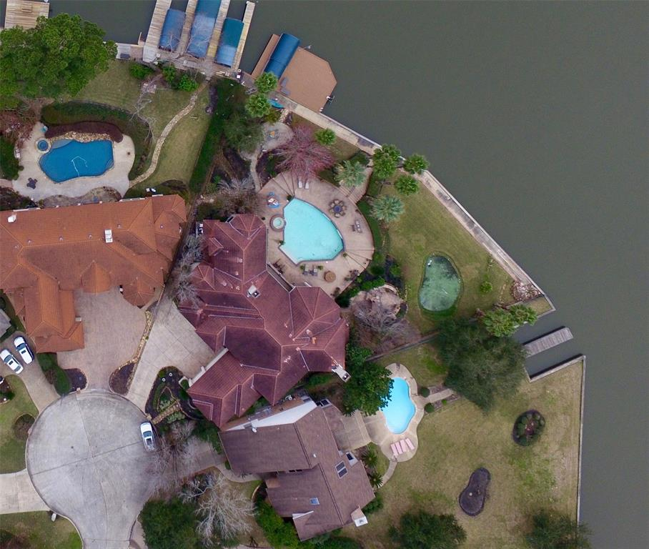 """This Waterfront Beauty on Lake Conroe is ready for Immediate Occupancy!! Enjoy the serene setting on the lake with breathtaking views from all areas.This is a perfect Generational Home, Family Retreat or fabulous Full Time Living on one of the premier waterfront POINT lots on Lake Conroe! Southern breezes make it easy to enjoy the multiple outdoor """"Fun Spots"""" here with a personal Putting Green, Grilling & Fireplace area surrounded by your favorite people, a Firepit, perfect for the cool weather approaching and the Sparkling Pool between! This Paradise is waiting for YOU ! Inside are multiple Living areas, Game & Media, plenty of Bedrooms with Baths and a centrally located Chef's Kitchen (an entertainer's delight) appointed with gas cooking, double ovens, temp control wine storage, wet bar, beverage coolers and so much more! One can enjoy Walden's award winning Golf Course, Health Club, Tennis, 2 privately gated boat ramps, walking paths & so much more! HISD, All amenities close by!"""