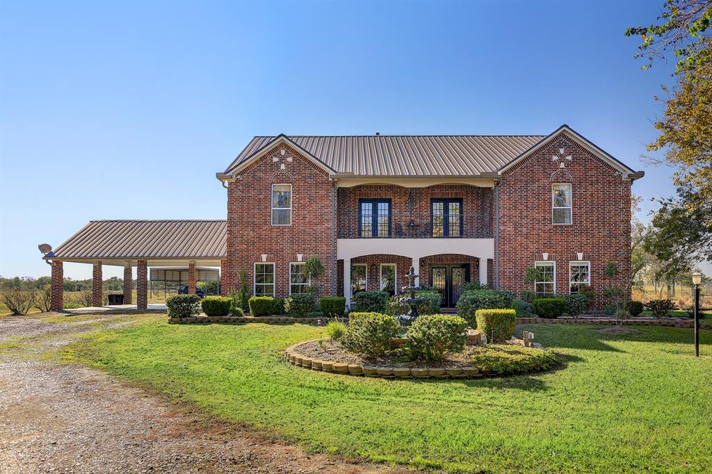 Escape to the country to this beautiful 4,500+ sf custom home with pool on 33 acres. This working mini ranch is is fenced and cross fenced with two ponds stocked with bass, loafing shed with corral, a 40' x 30' workshop and covered RV parking. The seller of this custom home is an engineer and no detail was overlooked in this professionally designed home. Concrete piers were placed prior to the slab being poured, OSB plywood is under all exterior surfaces and hurricane strap reinforcements were used on framing. The interior of this magnificent home features engineered hardwood and tile floors, large gameroom downstairs, 4 bedrooms ( a 5th bonus room with closet could easily be converted to a 5th bedroom) and 4 full baths. The open concept kitchen features granite counters, custom oak cabinets and gas appliances. There are two bedrooms down and two bedrooms up. In addition to the bonus room, there is a full media theater room upstairs.