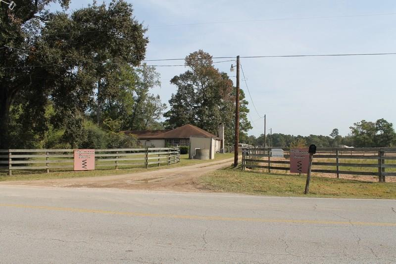 Buyers welcome to your dream!!  20 acres of ranch land that has been subdivided to residential, agriculture, income.  Property can accommodate horses, cows, pigs, and livestock of all kinds.  Barns, stables, riding pins, full size riding ring all included.