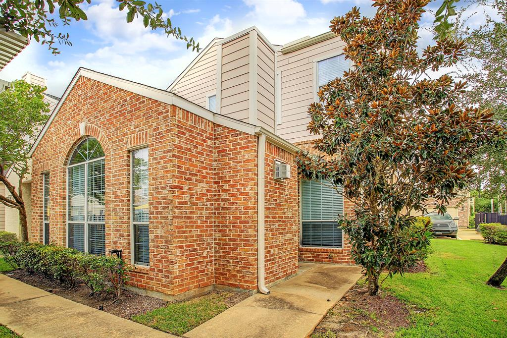 This lovely end unit town home sits in a gated community with a pool.