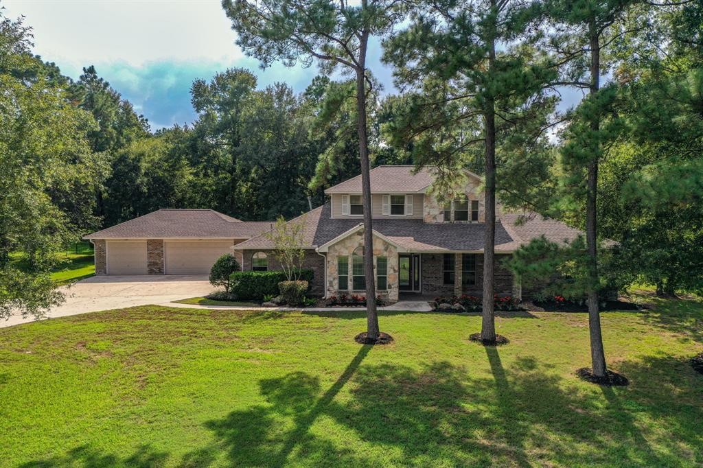 All I want for Christmas is this AMAZING home in Benders Landing! It's move-in ready & perfectly positioned on a full acre among gorgeous trees! Enjoy the Benders Landing lifestyle & acreage living zoned to the top Conroe Isd schools! Put your walking shoes on & within minutes are at the community park, playground, & sports courts to meet up with friends. There is a BRAND NEW Roof, New Carpet, & Fresh Paint too! The hand-scraped wood floors gleam throughout the main living areas. Popular layout with three bedrooms down. Designer touches include custom built-ins the executive study, formal dining, den, game room, & master closet. Stainless appliances accent the grand kitchen with an over-abundance amount of storage. The large kitchen island is a beautiful focal point. There is both a 4 burner electric stove top & 4 burner gas stove top, so bring on that holiday cooking! Perfect for entertaining both indoors & out w/the sparkling pool, spa, & playlet. Just what you have been looking for!