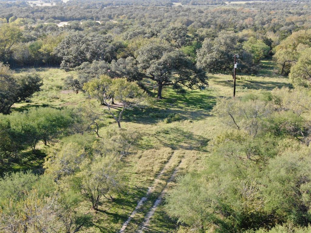 This gorgeous property would be a perfect place to build your dream home along with using as  recreational, hunting and ranching property. This property has so much to offer with all the trees, well maintained fences, water well and electricity its just waiting for you!!