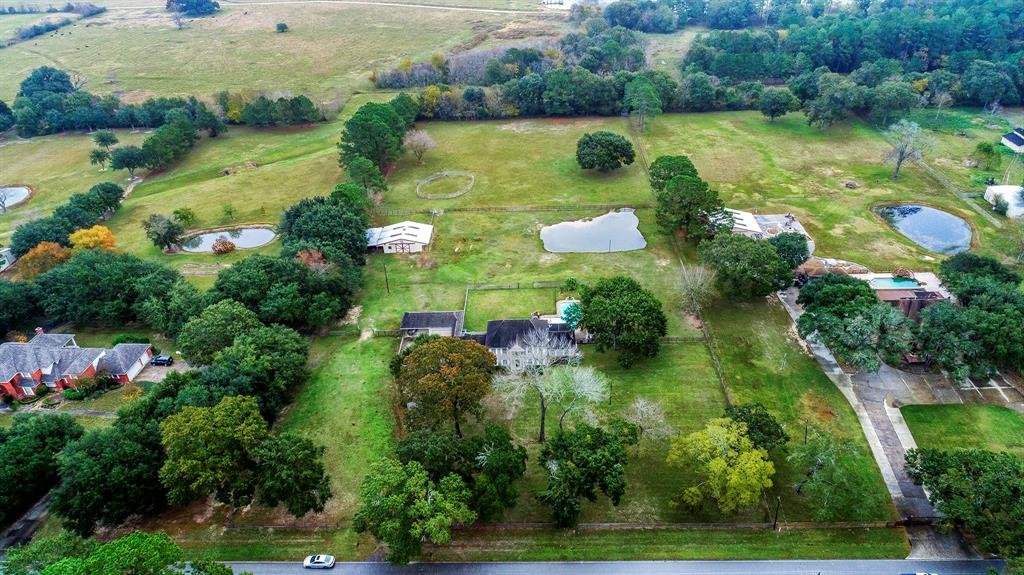 Private oasis located in prestigious Cypress Wood Estates. Bring the horses! 4.82 acres with a 1,317 SQFT 4 stall barn that can be converted into a 5 stall (currently used as hay storage), separate feed/tack room. Utility storage area attached to barn with double 12 foot gates to store mowers, tractors, ect. Pastures are cross-fenced for the ability to rotate your equine friends. Fully stocked pond located in middle pasture. Saltwater pool with extra securityfence. Backyard is fenced with pet wire to keep your dogs and horses separate! The stunning Colonial style home is 3,270 SQFTwith3 bedrooms 2.5 baths, double living areas, double dining areas, over-sized utility room and study that can be used as a 4th bedroom. 3 gas/wood burningfireplaces. Seller has proudly maintained this private oasiswith too many upgrades to list. Please see attached upgrade list. This property has never flooded and backs up to 140+ acres of ranch land.