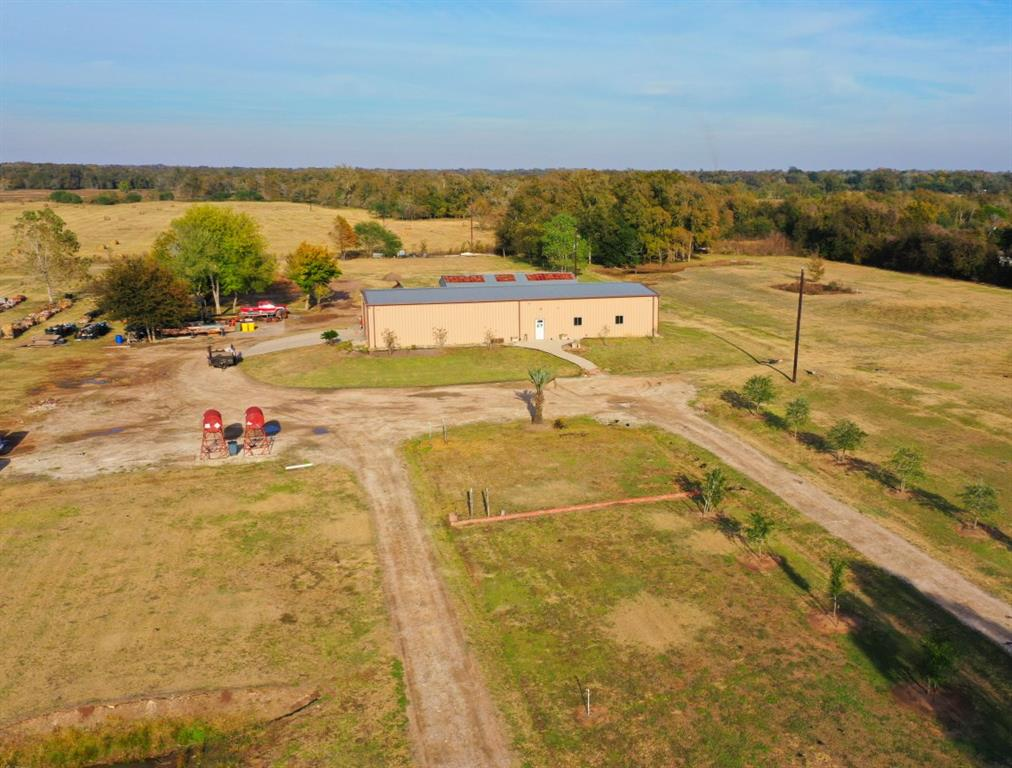 10 Acre property located between Katy and Sealy just 1/2 mile off of I-10!  100'x 40' building built in 2016 sits high and dry on the property!  **AC and Heated ** Office space, Restrooms, break room, and foyer, areas approx 2000 sq feet.  The other half is a warehouse with it's own half bath.  2nd building is 40' X 25' approx. currently used for welding shop.  Warehouses ready up for a small business owner/distributor.   Or, convert the space to a Barndominium!  The  surrounding area has other single family homes, ranches, and equine facilities.  Ideal size for the project minded DIY buyer looking for the right location!    Extra parking, 2 wells and aerobic septic system have been well maintained.  Owner, as a golf enthusiast & built 5 tee boxes for driving and chipping practice.   All showings must be accompanied.  Property is currently used for a commercial landscape company.  Make sure to click the links for drone video tours and other information about this unique property!