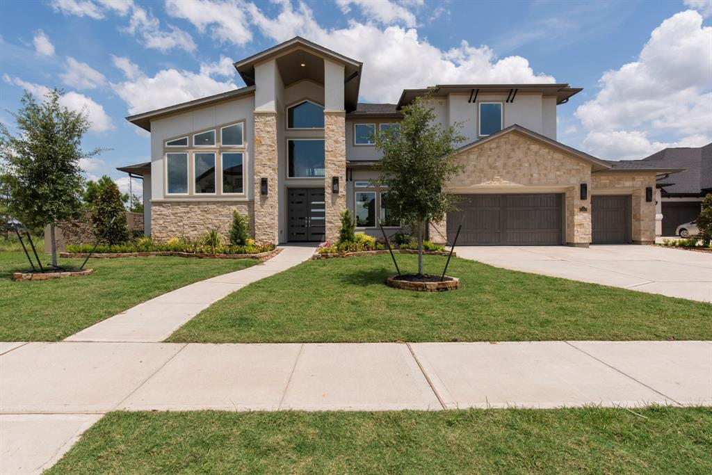 Award winning custom luxury home builder, Partners in Building's new neighborhood in the exclusive Sora Lakes of Cross Creek Ranch. This stunning custom home sits on a corner lot featuring a contemporary stair case, with a raised study. The large island kitchen offers an upscale appliance package, designer lighting, and a walk-in pantry. Extend your entertaining to the first-floor game area with media room, open plan with 2 story family room, formal dining and breakfast room, secondary bedroom and full bath with access to the spacious patio area. Extensive trim work and molding throughout accentuate the unique upscale finishes and custom craftsmanship PIB is known for. Expansive master suite offers a huge walk-in closet and a spa bathroom with a gorgeous double sink and a walk in shower & freestanding tub. Second floor has three bedrooms and a unique loft area off of the bridge.