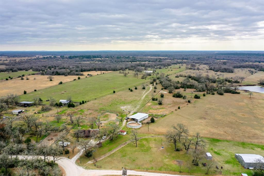 All owned mineral rights will convey upon closing. This is a 50.50 acre tract, is unrestricted and is both Robert Flemming, Tract 10 (4.73) and Robert Flemming, Tract 10-5 (45.77). The home located on the property will make a great hunting or recreational cabin or for use while your dream home is being built on any of several beautiful homesites on the property. It would then have potential as income producing property. Barn with stalls and corrals as it is currently a working horse farm. There is an additional site with separate septic and electric for a mobile home or RV. Wooded clusters throughout, ponds and abundant wildlife, fenced. This is Madison County unrestricted property at its finest. Bring your country home dreams.