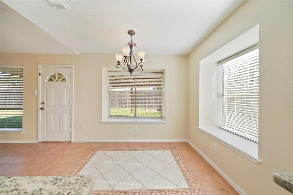 Formal dinning area features large windows with plenty of natural light.