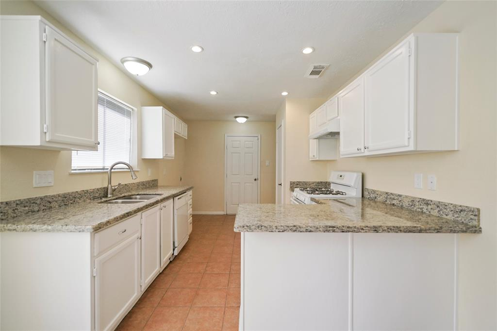 Nice size kitchen with granite counter tops.