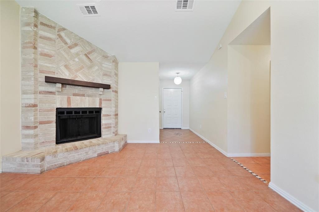 Home features spacious living with a corner brick fireplace to enjoy during those colder months.