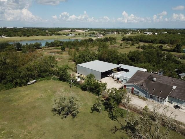 THIS IS THE PERFECT LOCATION TO LIVE AND RUN YOUR OWN BUSINESS. IT HAS OVER 5.5 ACRES WITH